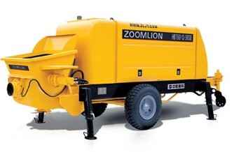 Yellow concrete trailer pump against a white back ground.